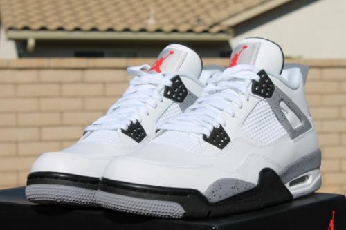"3e769fd9760 Sneaker Game Proper  Kanye West Rocking Air Jordan IV ""White Cement"""