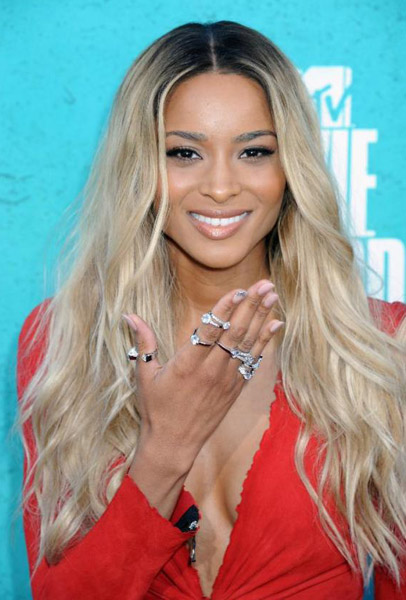 Ci Ci looked very stunting in a red Balmain mini dress paired with nude ...
