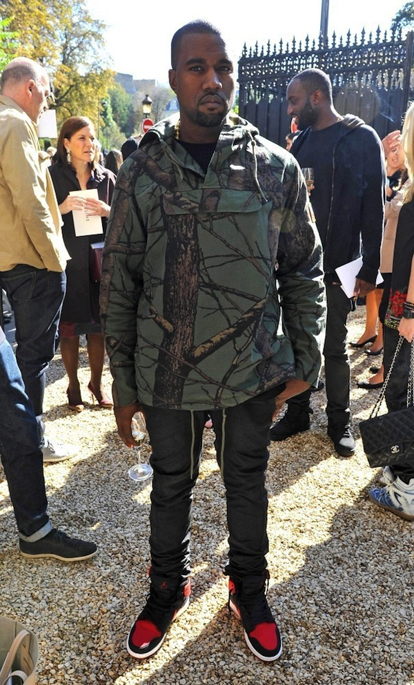 watch a44ba 5c204 Kanye West Rocking A Supreme Green Tree Camo Field Pullover