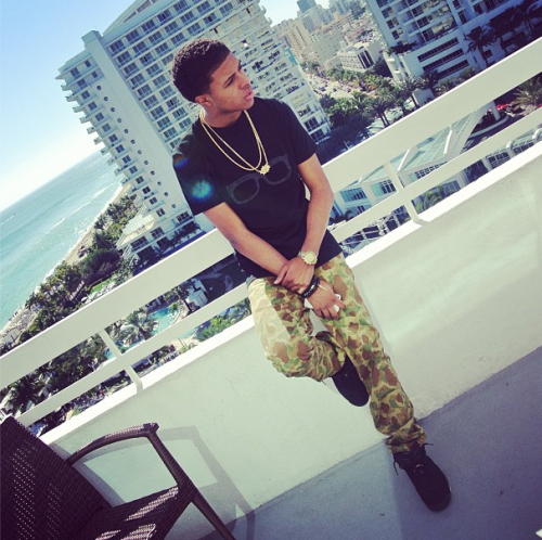 730bc6711a118b Diggy Simmons was photo d standing on a balcony in a nice looking vacation  spot. The teen rap sensation was looking very cool too!