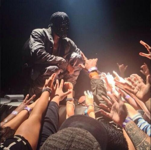 Kanye-engages-with-the-crowd-on-the-Yeezus-tour